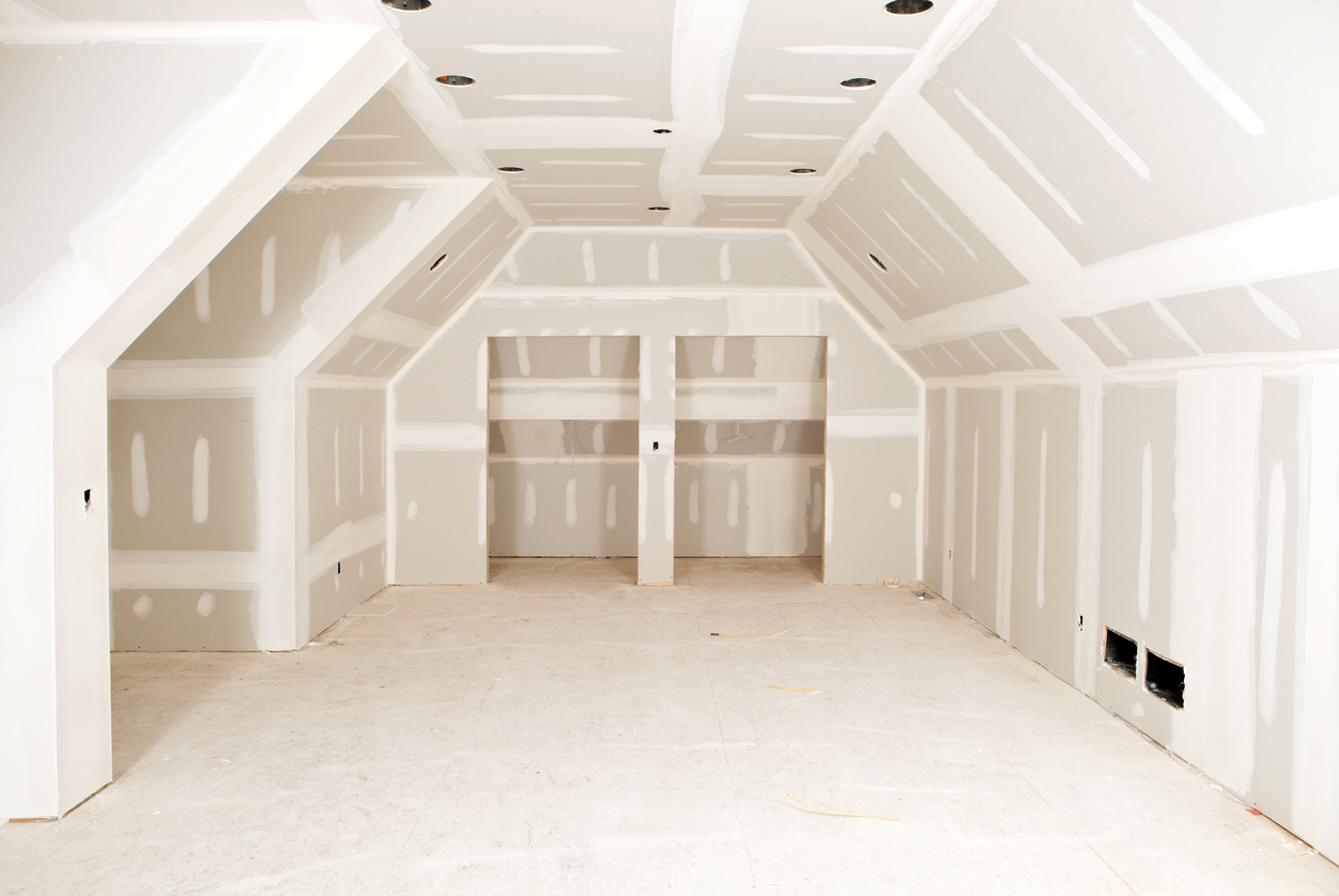 """A new bonus room, with complex angles, at a residential construction site with tape and mud on the drywall seams.A related image from my portfolio:"""