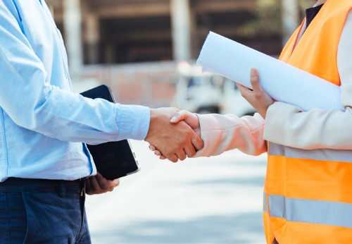 Painting Contractors in Springfield IL making an agreement with a business owner