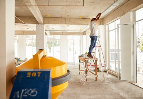 A builder setting up lighting during Interior Contracting in Peoria IL
